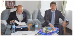 HE. Ambassador sited right with his aid in VC's office on their visit.